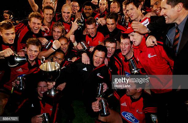 The victorious Crusaders celebrate with the trophy they beat the Brumbies 3113 in the Super12 rugby final at Jade Stadium Christchurch Saturday