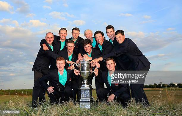 The victorious Great Britain and Ireland team with the Walker Cup trophy after their 16.5 to 9.5 win during the final afternoon matches in the 2015...