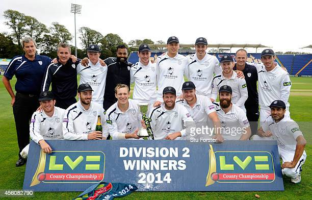 The victorious Hampshire team and staff celebrate with the trophy after winning the Division Two Championship after beating Glamorgan on day three of...