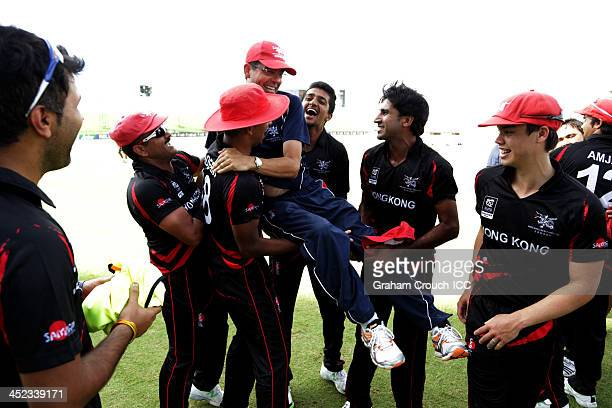 The victorious Hong Kong team hoist their coach following their victory in the Papua New Guinea v Hong Kong Quarter Final match 64 at the ICC World...