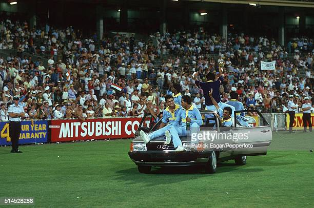 The victorious Indian cricket team take a victory lap of honour after winning the Benson & Hedges World Championship of Cricket Final between India...
