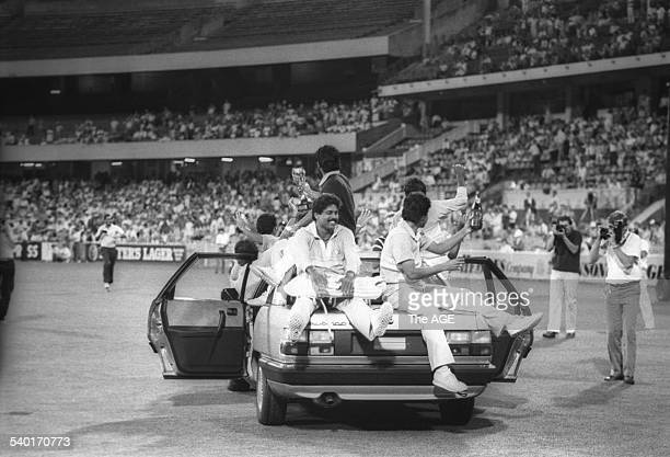 The victorious Indian cricket team, with Kapil Dev, take a victory lap of honor after winning the Benson & Hedges World Championship of Cricket,...