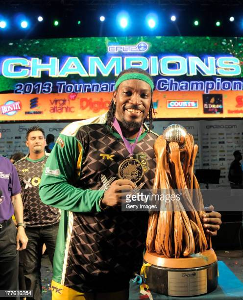 The victorious Jamaica Tallawahs Captain Chris Gayle poses with the Trophy after winning the Final of the Cricket Caribbean Premier League between...