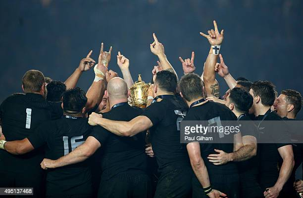 The victorious New Zealand players celebrate with the Webb Ellis Cup during the 2015 Rugby World Cup Final match between New Zealand and Australia at...
