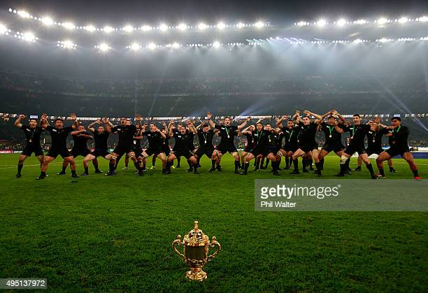 The victorious New Zealand players perform the Haka to celebrate winning the Webb Ellis Cup during the 2015 Rugby World Cup Final match between New...