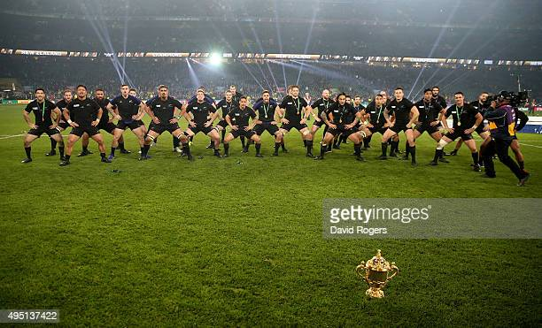 The victorious New Zealand team perform the Haka behind the Webb Ellis Cup to celebrate winning the 2015 Rugby World Cup Final match between New...