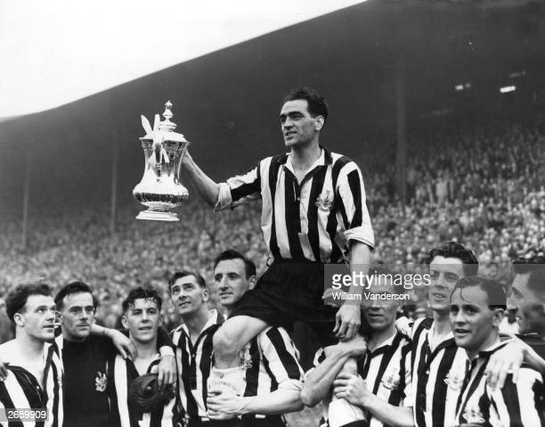 The victorious players of Newcastle United lift captain Joe Harvey and the FA Cup trophy on their shoulders in celebration after their 10 victory...