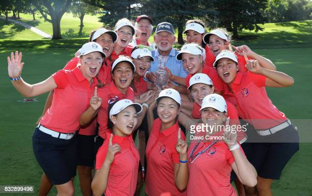 The victorious United States team celebrate with the trophy and John Solheim the President and CEO of the Ping Compant at the conclusion of the 2017...