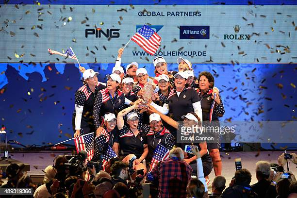 The victorious United States Team celebrate with the trophy during the closing ceremony during the final day singles matches in the 2015 Solheim Cup...