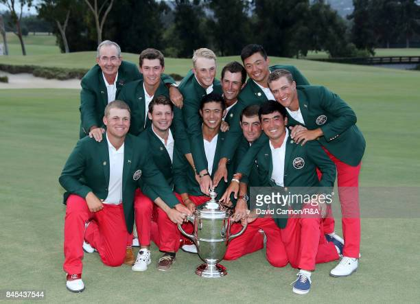 """The victorious United States team led by captain John """"Spider"""" Miller pose with the trophy after their 19-7 victory in the 2017 Walker Cup at the Los..."""