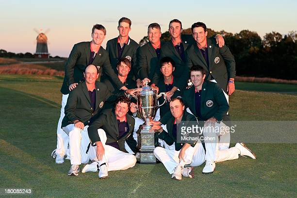 The victorious United States team poses with the Walker Cup after Day Two of the 2013 Walker Cup at National Golf Links of America on September 8...