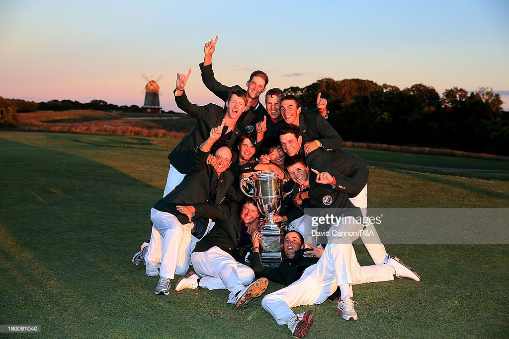 The victorious United States Walker Cup team with the trophy at the closing ceremony after they had won the match by seventeen points to nine in the 2013 Walker Cup Match at The National Golf Links of America on September 8, 2013 in Southampton, New York.