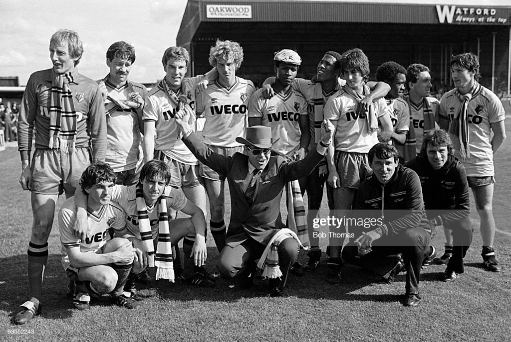 The victorious Watford team at the end of the season celebrate finishing second in Division 1 with chairman Elton John after beating Liverpool 2-1 at Vicarage Road Stadium, Watford on 14th May 1983. Back row, left to right: Steve Sherwood, Steve Sims, Kenny Jackett, Paul Franklin, Luther Blissett, John Barnes, Nigel Callaghan, Worrell Sterling, Wilf Rostron and Pat Rice. Front row, left to right; Jan Lohman, Martin Patching, Elton John (chairman), Graham Taylor (manager) and John Ward (assistant manager). (Photo by Bob Thomas/Getty Images).