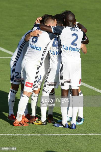The Victory celebrate a goal by Leroy George of the Victory during the round seven ALeague match between Perth Glory and Melbourne Victory at nib...