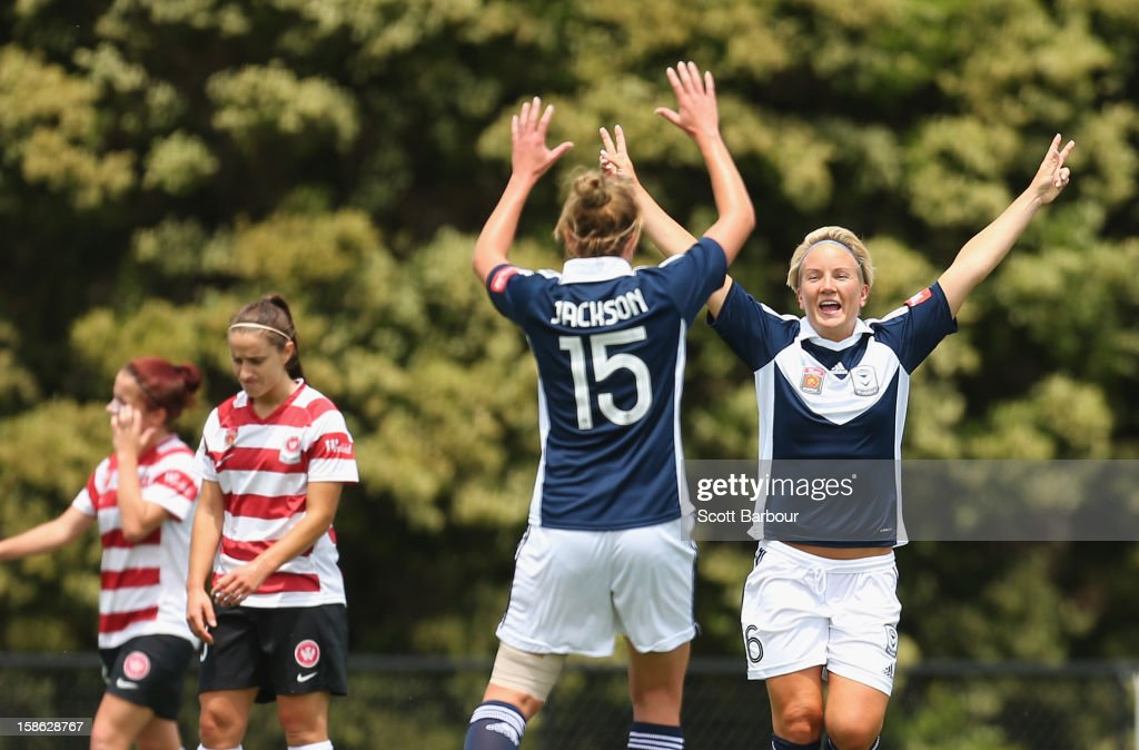 The Victory celebrate after Petra Larsson (R) scored her teams first goal during the round 10 W-League match between the Melbourne Victory and the Western Sydney Wanderers at Wembley Park on December 22, 2012 in Melbourne, Australia.