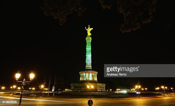 The Victory Column or Siegessaeule stands illuminated during the Festival of Lights on October 13 2009 in Berlin Germany Landmarks across Berlin will...