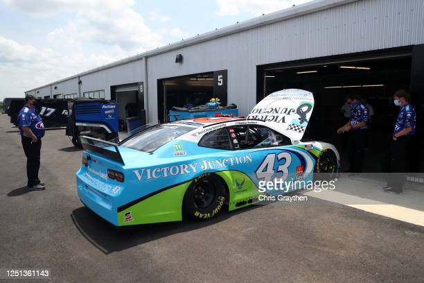 The Victory Junction Chevrolet driven by Bubba Wallace waits in the garage area prior to the NASCAR Cup Series GEICO 500 at Talladega Superspeedway...