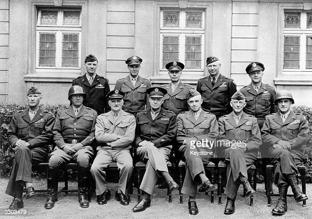 The victory meeting of American Generals at General Bradley's headquarters. In the group are General George Patton, , , head of the 3rd Army, ,...