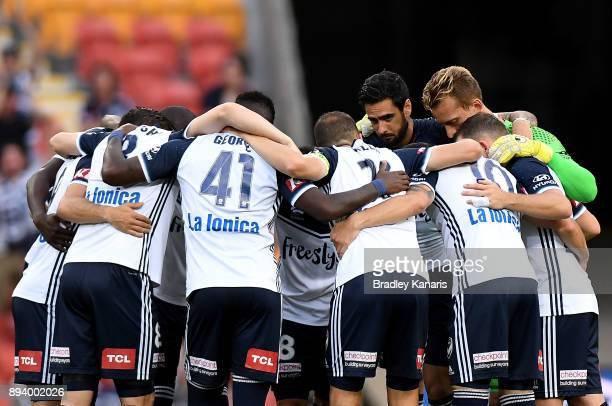 The Victory players embrace before the round 11 ALeague match between the Brisbane Roar and the Melbourne Victory at Suncorp Stadium on December 17...
