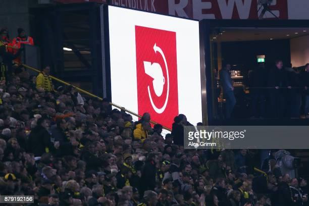 The Video Assistant Referee VAR logo is seen on the screen as referee Deniz Aytekin takes back a Schalke goal during the Bundesliga match between...