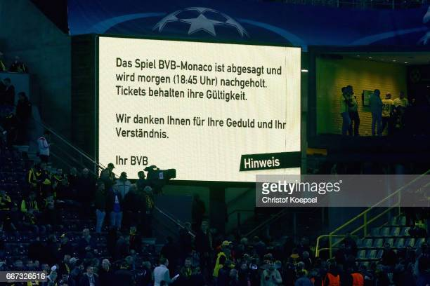 The video board announces the match cancellation of the UEFA Champions League Quarter Final first leg match between Borussia Dortmund and AS Monaco...