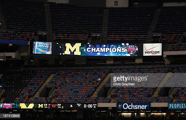 The video board declares the Michigan Wolverines Champions after they 2320 overtime win against the Virginia Tech Hokies during the Allstate Sugar...