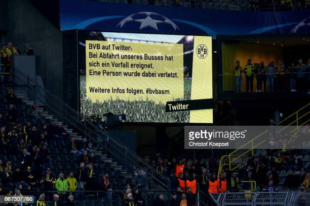 The video board reports about a bomb attack to the bus of Dortmund prior to the UEFA Champions League Quarter Final first leg match between Borussia...