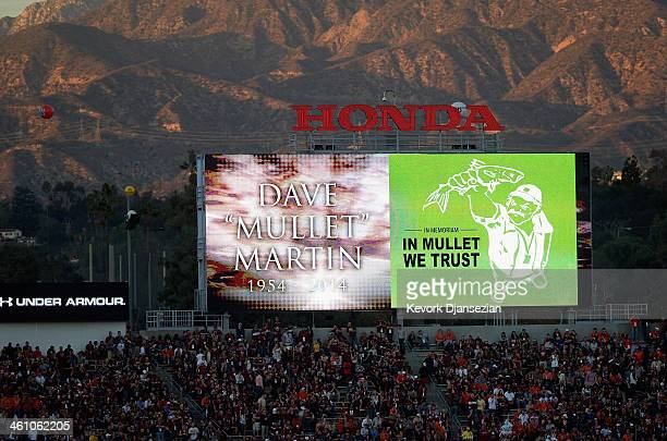 The video board shows a tribute to AP photographer Dave Mullet Martin prior to the 2014 Vizio BCS National Championship Game between the Auburn...