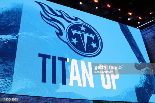 The video board shows the logo for the Tennessee Titans during the first round of the 2019 NFL Draft on April 25 at the Draft Main Stage on Lower...