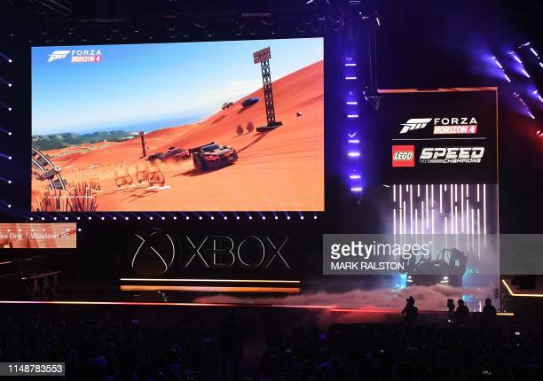 """The video game """"Forza Horizon 4"""" is promoted at the Microsoft Xbox the Microsoft Xbox press event ahead of the E3 gaming convention in Los Angeles on..."""