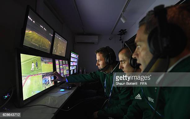 The video referee and assistants watch footage during the FIFA Club World Cup Playoff for Quarter Final match between Kashima Antlers and Auckland...