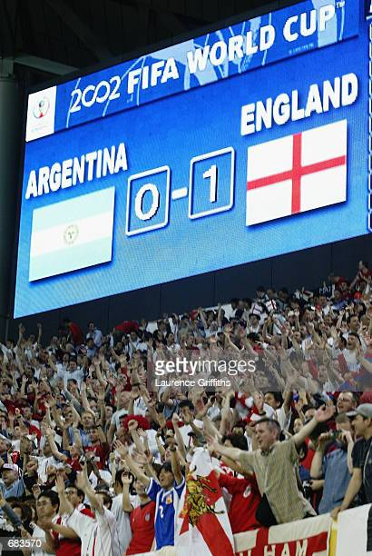 The video screen displays the score during the England v Argentina Group F World Cup Group Stage match played at the Sapporo Dome in Sapporo Japan on...