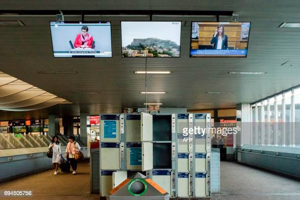 The video triptych 'Time as Activity Live AthensBerlin' by Argentinian artist David Lamelas welcomes visitors at the Kassel Wilhelmshoehe train...