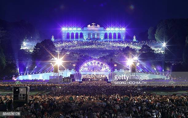 The Vienna Philharmonic Orchestra performs on stage during the open air concert 'Sommernachtskonzert' at the Schoenbrunn Palace in Vienna on May 26...