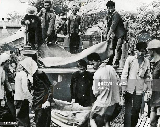 The Viet Cong crept in at night and slaughtered 23 of the laborers
