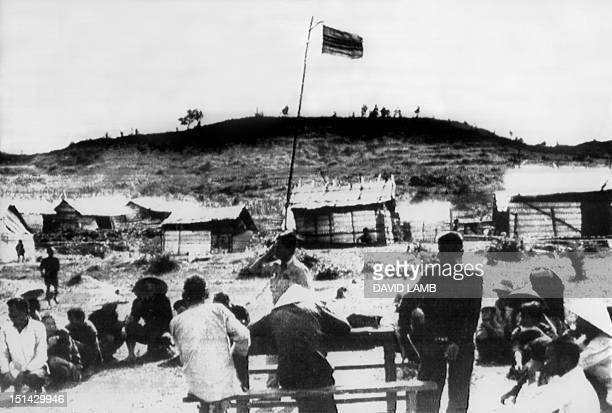 The Vietnamese flag flies over the village of Mai Lai 19 November 1969 where some 600 villagers were allegedly massacred by US Americal Division...