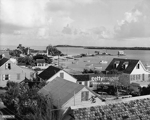 The view across town, over the boats in the bay, and towards neighboring islands, New Plymouth, Green Turtle Cay, Abaco, Bahamas, mid 20th Century.
