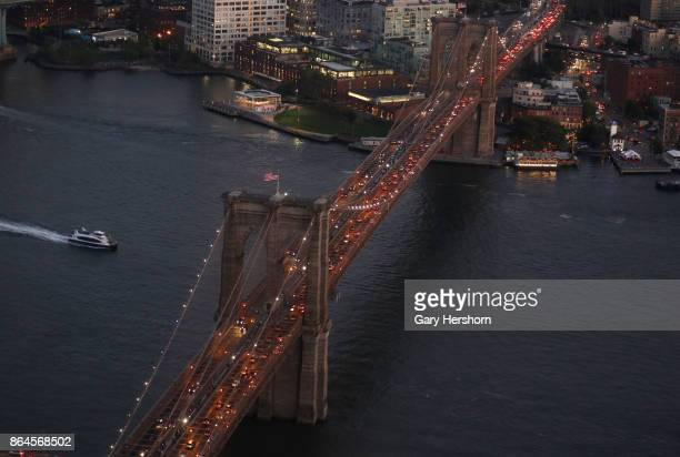 The view at sunset looking east of the Brooklyn Bridge from a 76th floor penthouse apartment at the lower Manhattan residential tower New York by...