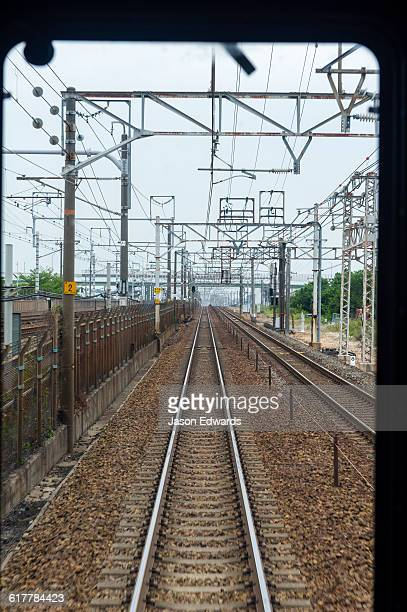 The view down the railway tracks from the train driver compartment.