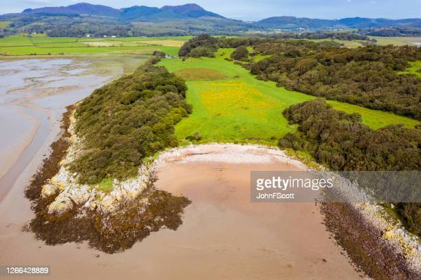 the view from a drone of a deserted scottish beach in dumfries and galloway, south west scotland - johnfscott stock pictures, royalty-free photos & images