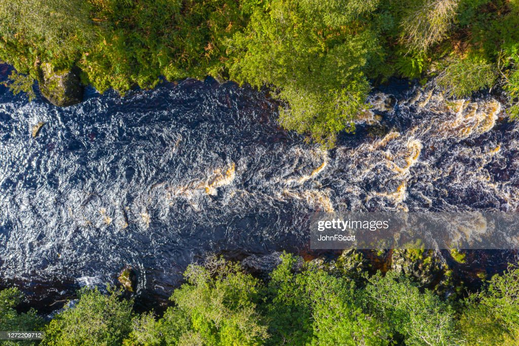 The view from a drone of a river in remote rural Dumfries and Galloway : Stock Photo