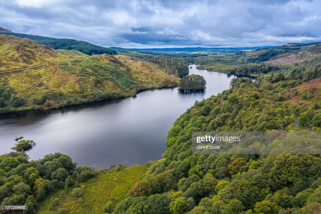 The view from a drone of a Scottish loch and woodland in Dumfries and Galloway on an overcast day : Stock Photo