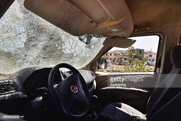 The view from inside a car destroyed by last night tornado on July 9 2015 in Venice Italy A tornado swept through the outskirts of Venice touching...