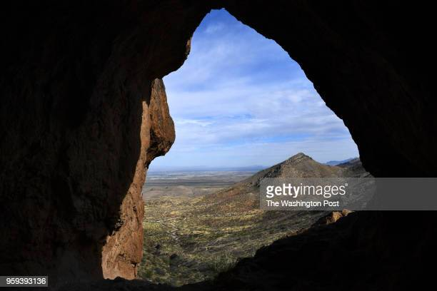 The view from inside one of three caves along the Aztec Cave Trail in Franklin Mountain State Park looks out over west El Paso New Mexico and Mexico...