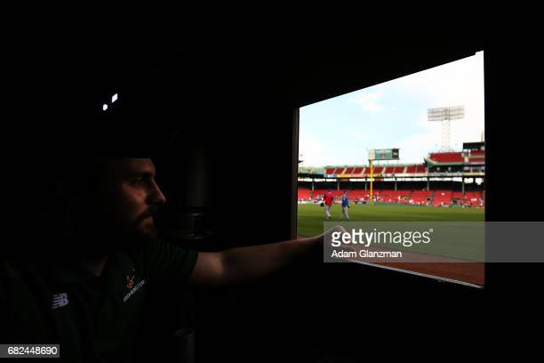 The view from inside the Green Monster as the Chicago Cubs warm up in the outfield before a game against the Boston Red Sox at Fenway Park on April...