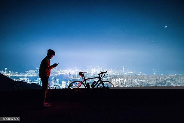 The view from Kowloon Peak shown apartment buildings and office blocks lights at night on November 3 2016 in Hong Kong Hong Kong Hong Kong is...