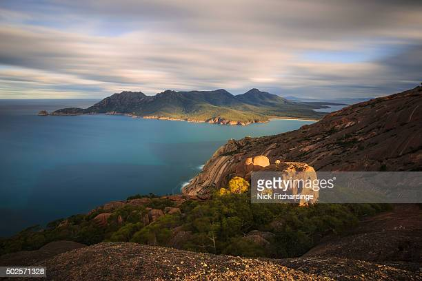 The view from the summit of Mt parsons looking out on Wineglass Bay and the Southern part of Freycinet Peninsula, Freycinet National Park, Tasmania, Australia