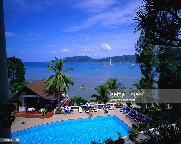 The view from your room in the Phuket Yacht Club, across the pool and over to Hat Nai Harn.