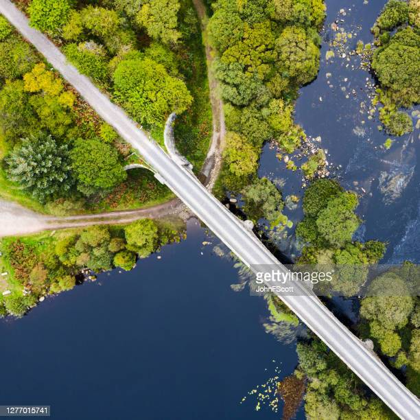 the view looking directly down on a disused railway viaduct in rural scotland - johnfscott stock pictures, royalty-free photos & images