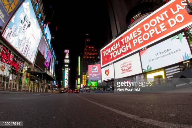 The view looking down an empty 7th Avenue at night in Times Square amid the coronavirus pandemic on April 22 2020 in New York City United States...